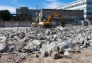 digger demolishing houses for reconstruction